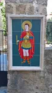 Икона святого Фанурия на заборе храма