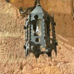 Средневековый светильник на стене храма